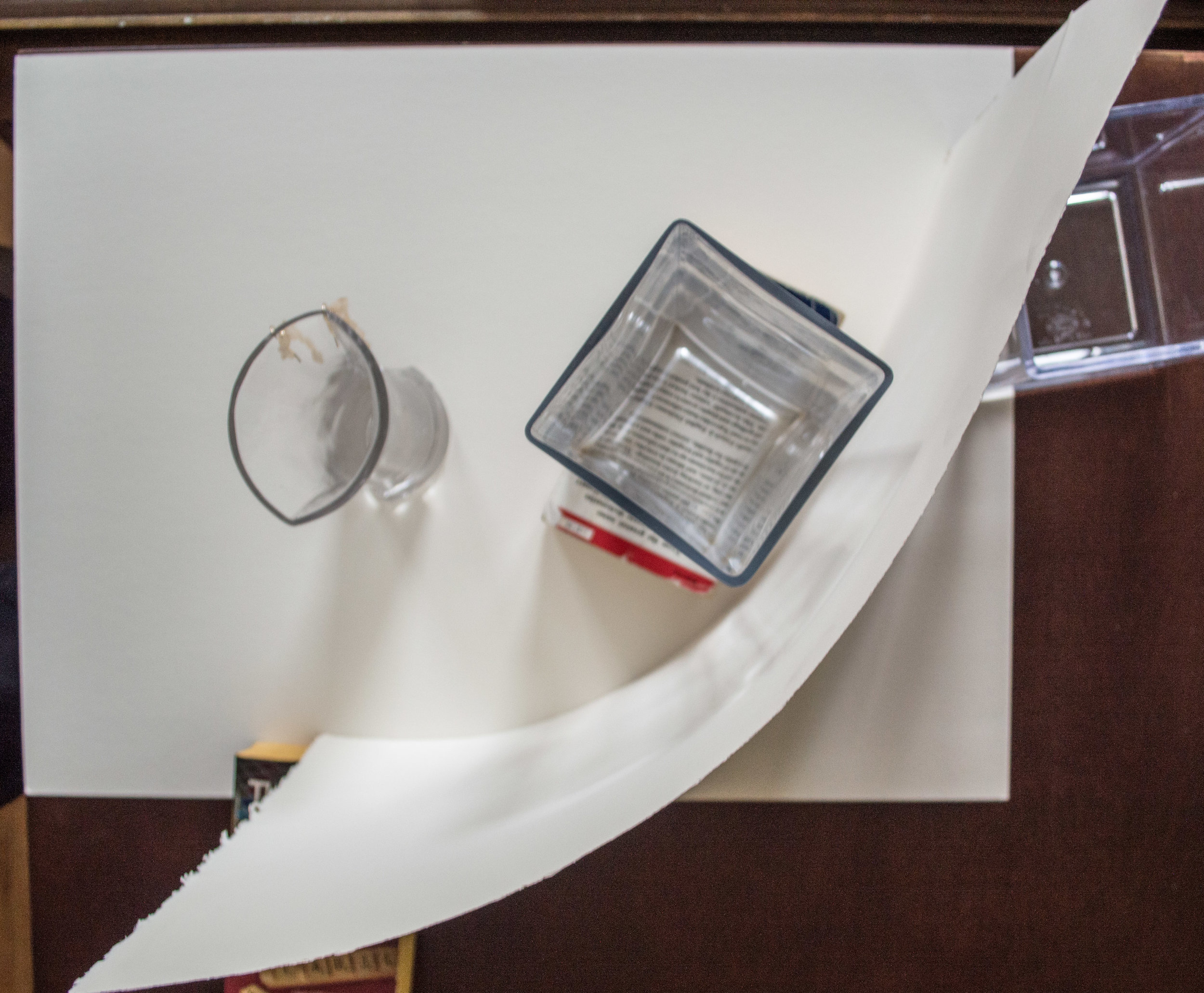 Similar setup, as seen from above. Instead of shooting into the window, this time I'm shooting perpendicular to the window, with glass-in-front-of-white-paper as the backdrop.