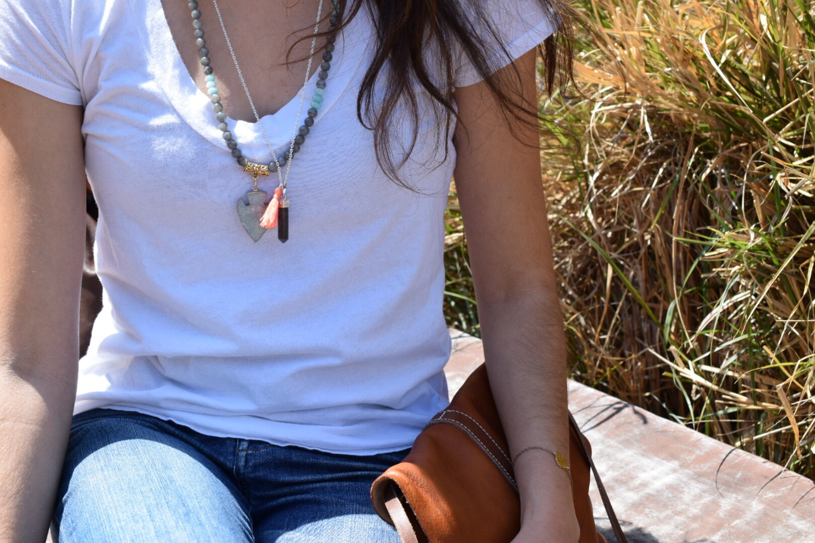 Some of the new pieces, labradorite arrowhead necklace and the tassel Quartz pendant.