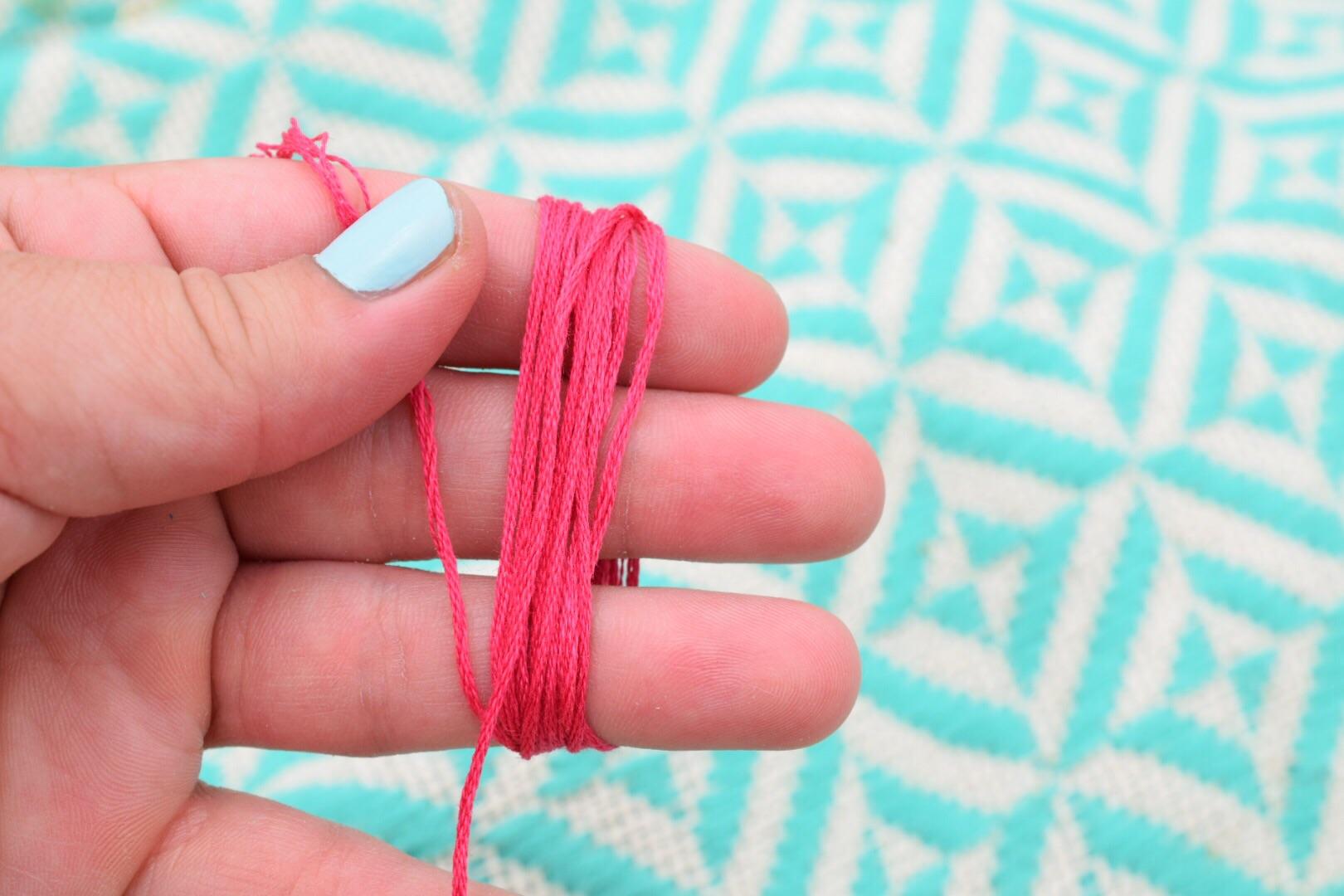 I used 1/3 of the string for each tassel.