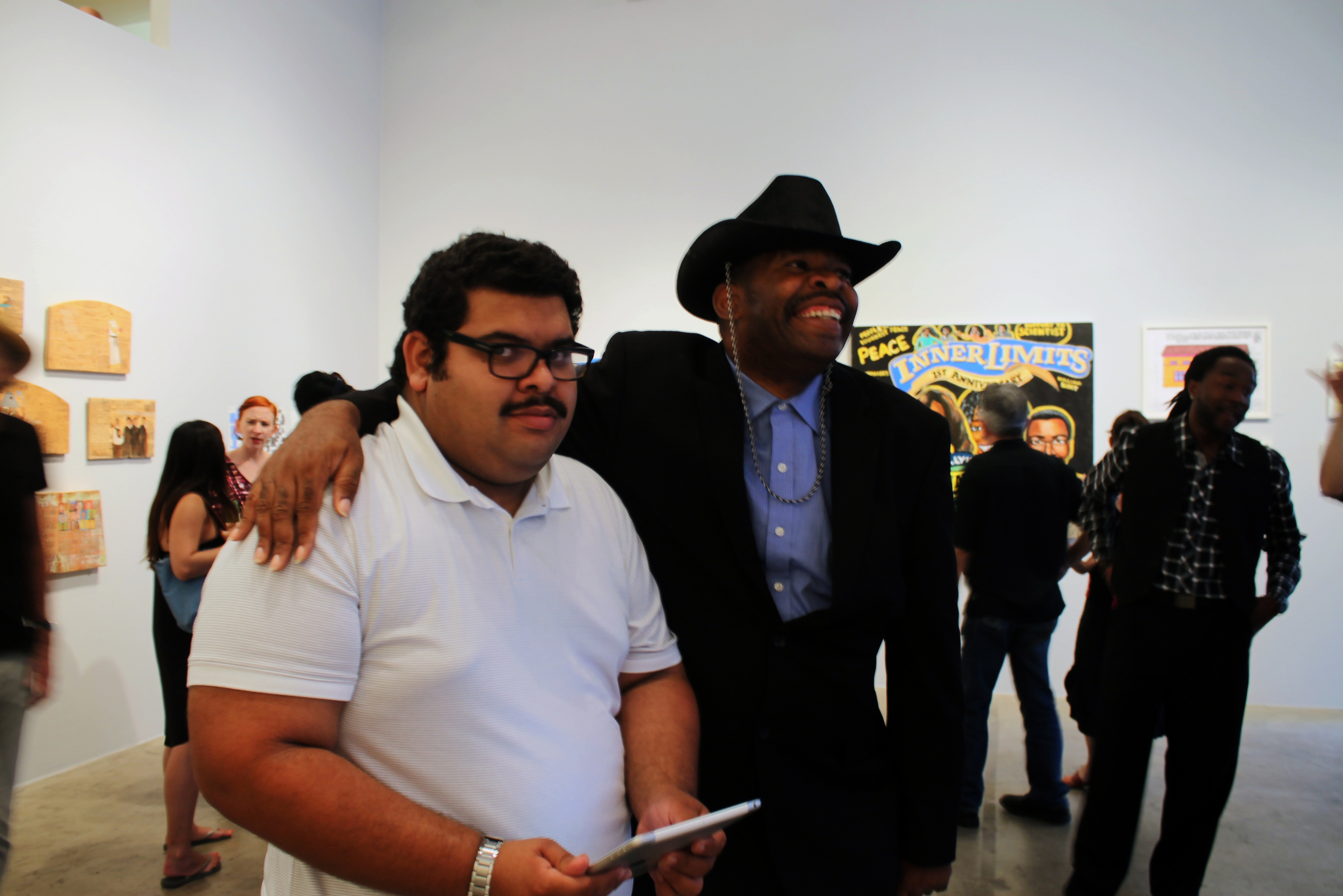 Joe Zaldivar (left) and William Scott (right) at the opening reception of  Mapping Fictions