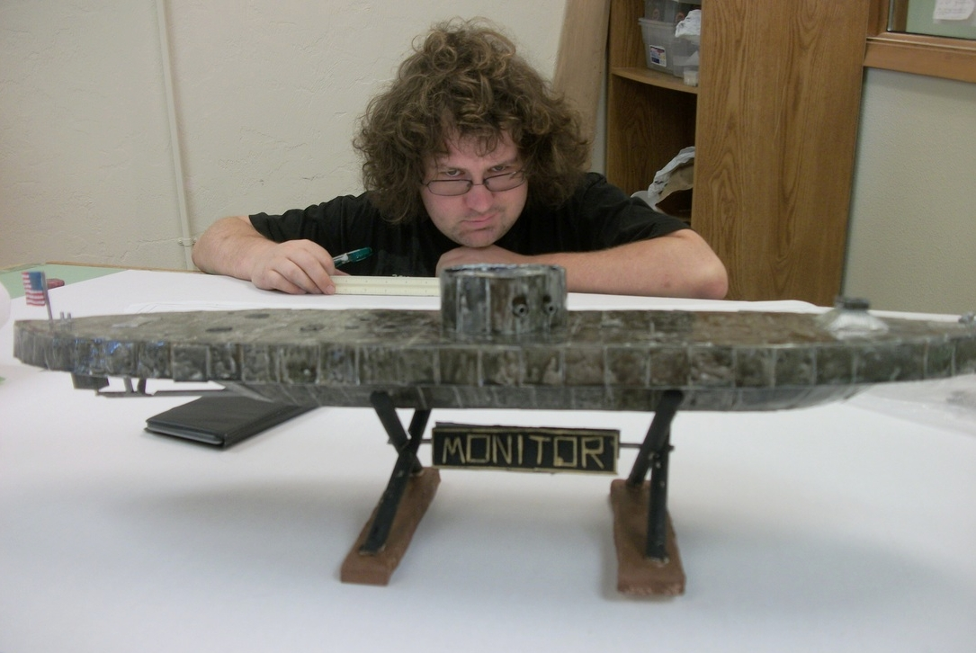 Patrick Hackelman with his model of the USS  Monitor