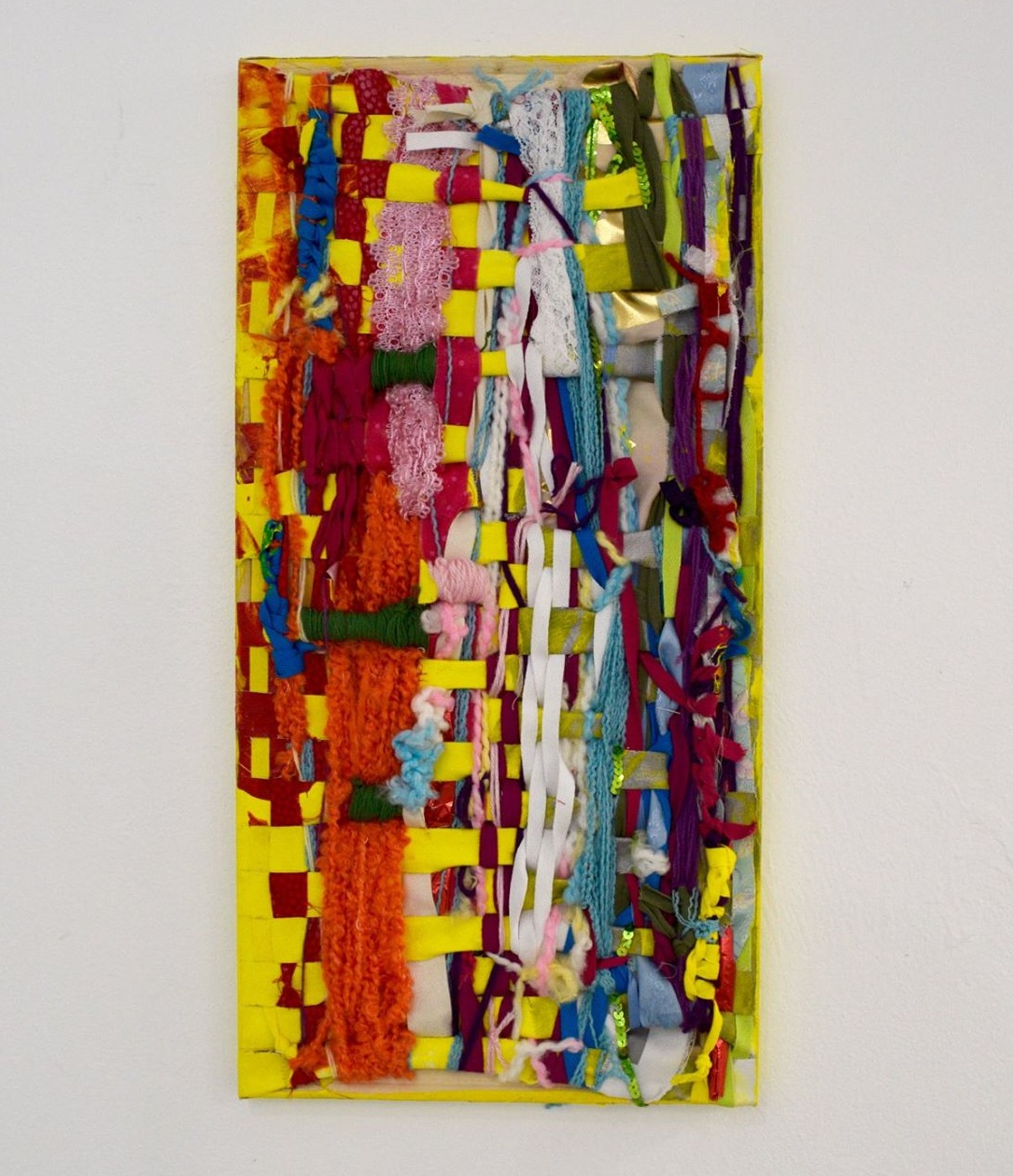"""Linda Ruzga,  Sunday , 2017, Yarn and fabric woven on stretched canvas, 12"""" x 24"""", images courtesy Circle Contemporary"""