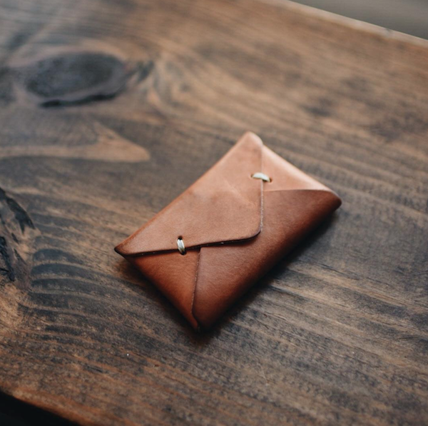 Sitting on that oversized wallet is awful on his back. Pick up this minimalist everyday leather wallet for his essentials.  15/15  Envelope Wallet in Tobacco  - $30