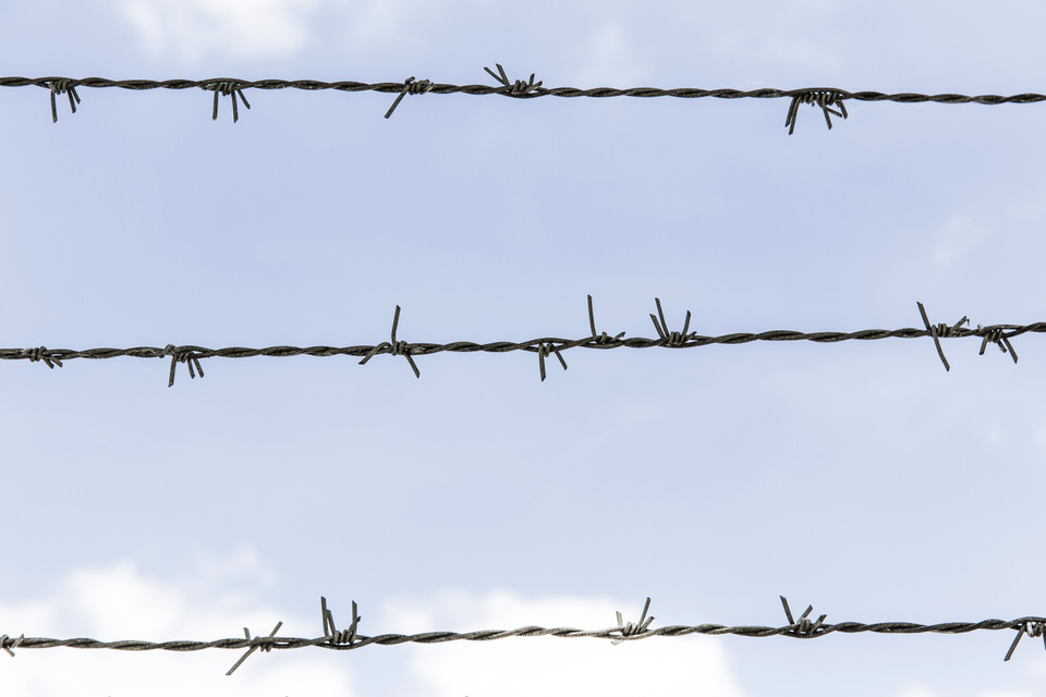 three-strand-barbed-wire-hold-up