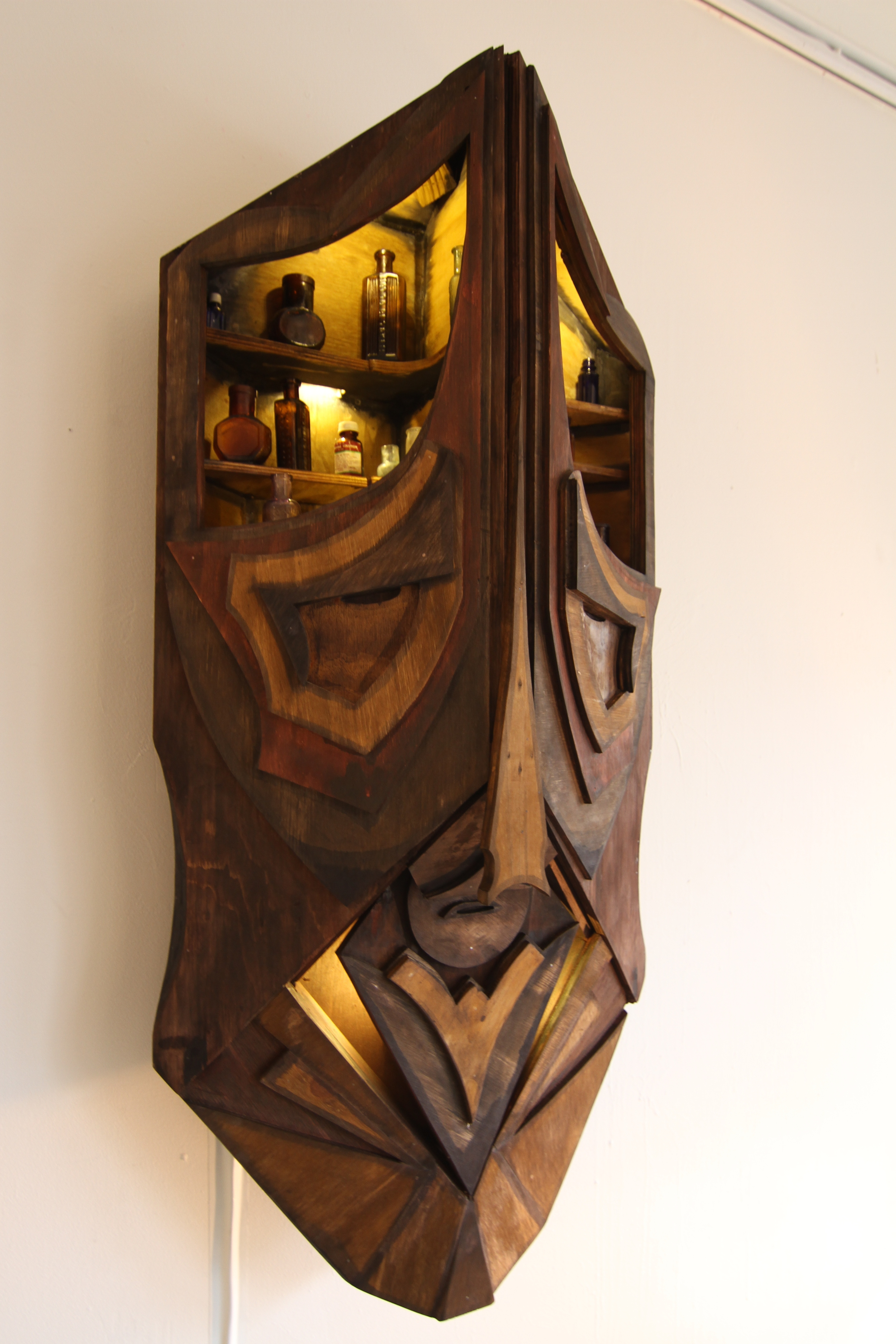 2012, Timber, found objects, LED, oil stain, 120x60x30cm, Photograph by Michael Herman