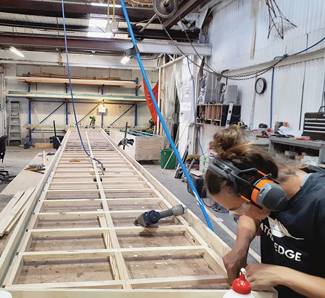 Nina placing the final pieces into the longest #shoji screen we've ever seen at over 8 meters for @darlinghursttheatreco . . #featheredgeworkshop #shojiscreen #setconstructionsydney #theatresetssydney #newcastlecreative #workshoppics #featheredge @tzatzikiskinnydip