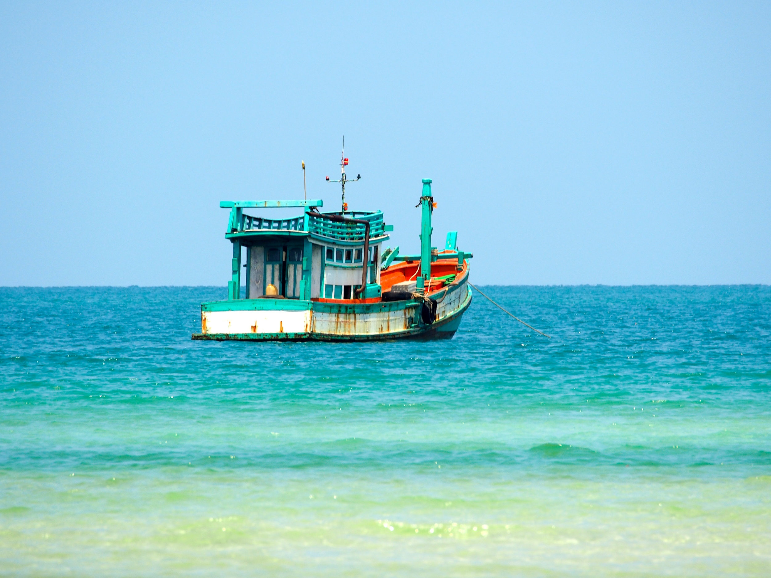 TMCP_Community_A fishing boat travels through the quiet waters of Koh Rong island.JPG