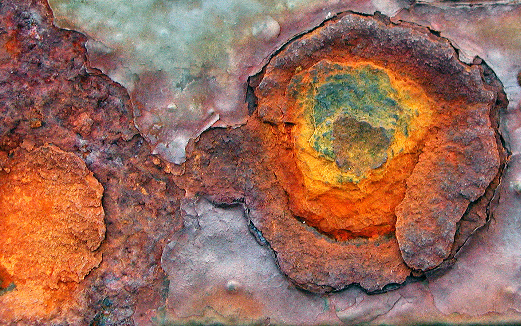 Rust on a ship hull. This process involving iron is called oxidation, when it's wood, we call it fire. Either way, oxygen is corroding the base material.