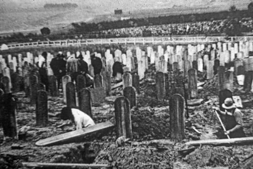 Chinese bonepickers moving through the Chinese cemetery in Colma, outside San Francisco. This process came to almost every Chinese cemetery in California.