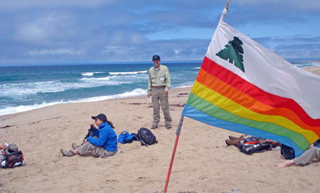 Santa Cruz County Flag, during BayWalk. South of Salinas River, Monterey County, date. Madelyn Choi and Kim Steinhardt in background.