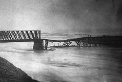 A winter flood in February, 1881 broke not only the railroad's trestle across the San Lorenzo River, but also the company's financial back as well.