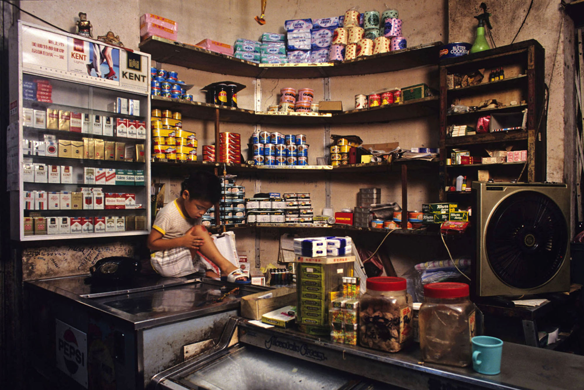 Young boy in family-run shop, 1990