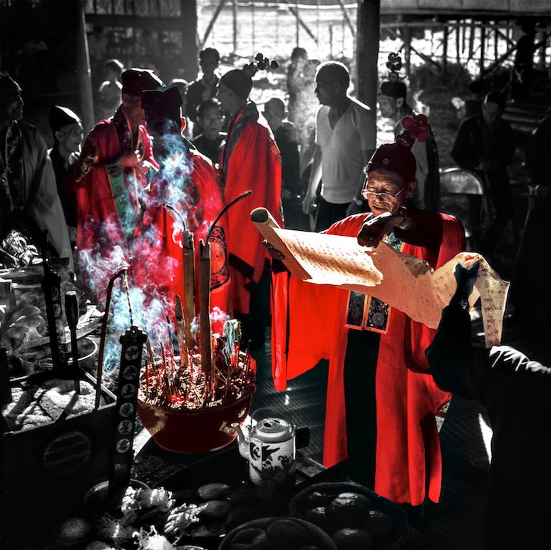 Tai Chiu Festival, priest reading donations list