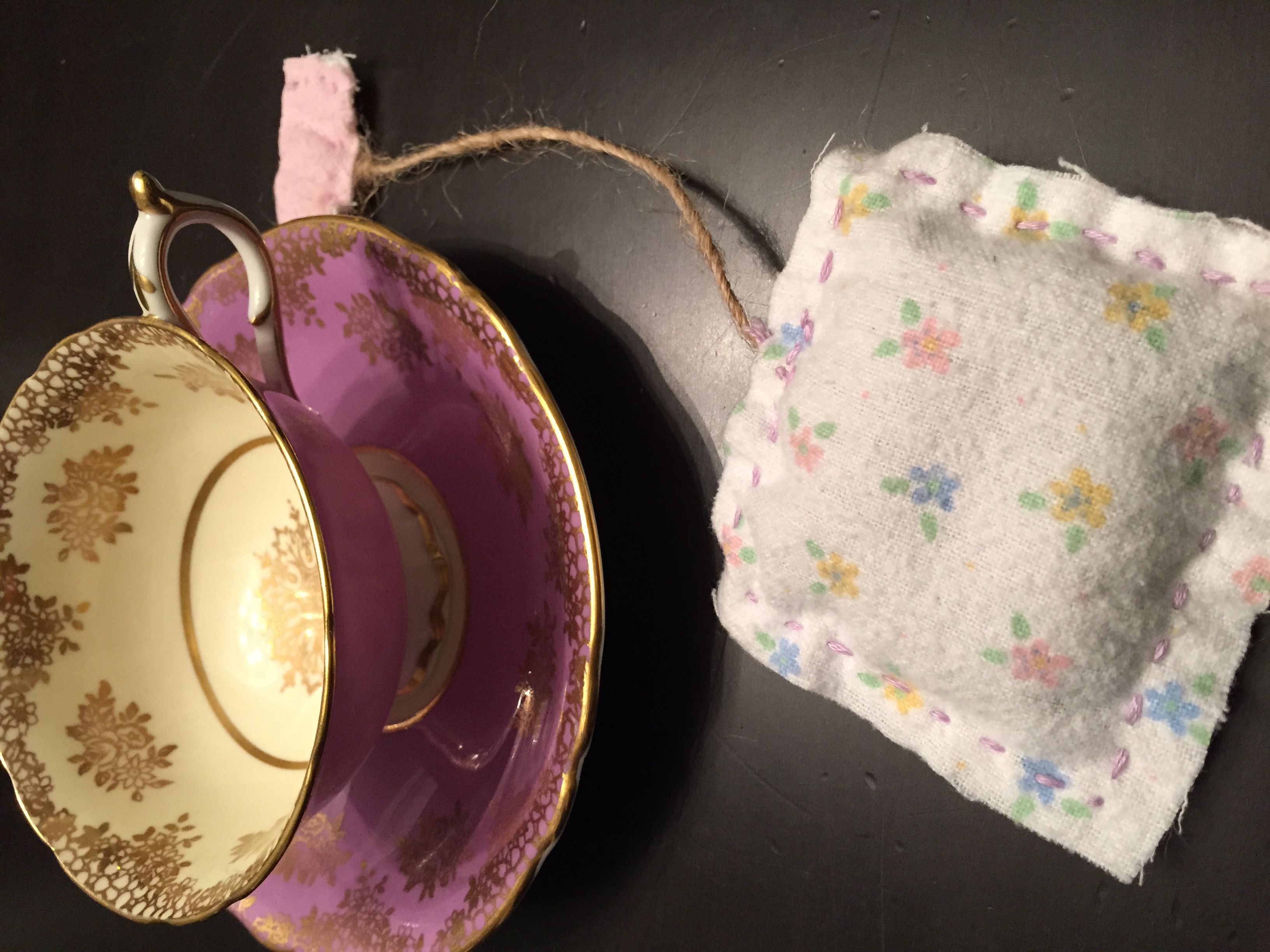This is a very special tea cup passed down generations to my daughter, not to be mistaken for ones we bought at Good Will. The cloth was different on each side of the tea bag, filled with lavender and sewn together by family and friends. Thanks Jay-Jay, Raleigh and Heather Dinger! Total cost per goodie bag: $2 for cup and saucer, $1 for lavender, cloth, twine and embroidery thread = $3 each for 12 girls - $36.