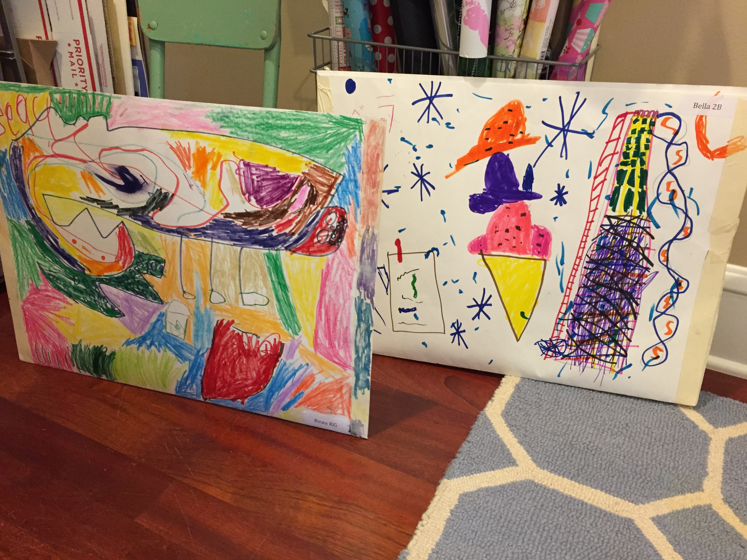 These two pockets came home with my kids at the end of the school year (June 2015). The teachers took two poster boards and taped them together to create a big portfolio to hold artwork throughout the year. I will use these same pockets to collect artwork this whole school year 2015-2016. When it's time to send the grandparents their art books in September 2016, I will take apart these two pockets, which equals 4 poster boards in total and use 3 out of the 4 poster boards. Fold each in half and use them as envelopes for the art books. One poster board remains for next year. Recycling at it's finest.
