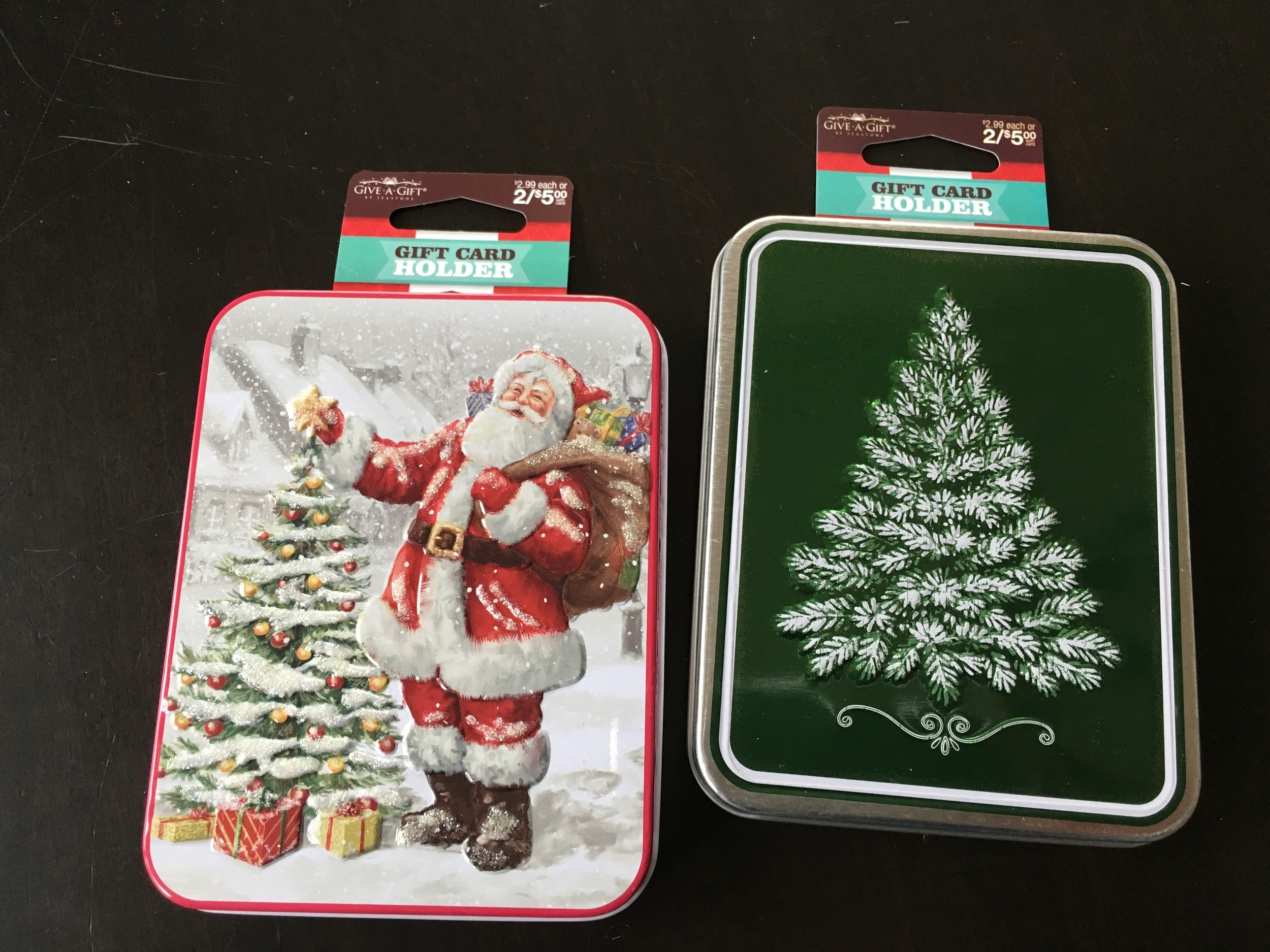 These tins measure 3.5 x 4.5 inches and are a half inch thick. Inside is a black fake velvet insert with a little area to nestle the gift card. After, the insert could be taken out and the tin could be used for other treasures. Do the math - half of $5.00 is $2.50 for two tins!! Gift card holders should be on your radar when you shop the sales after Xmas this year.