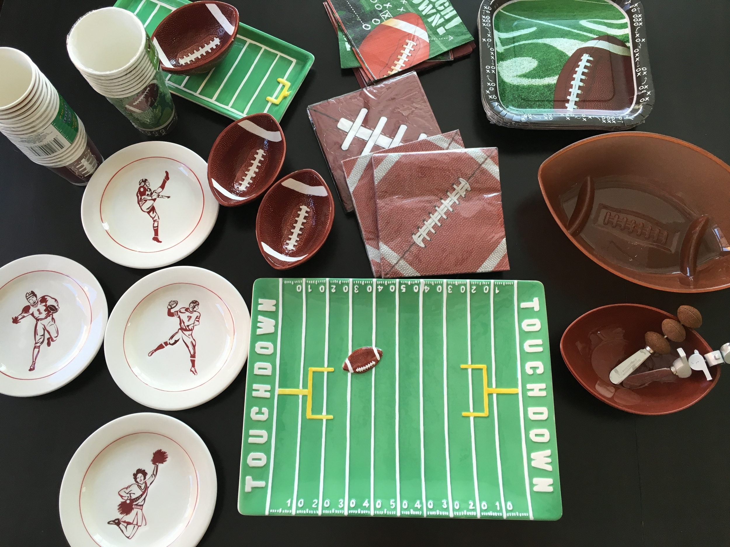 I love using these items to make our Super Bowl celebrations festive. The vintage small eats plates and the whistles & football spreaders (inside the football dish)were gifts from my cousin Jay-Jay. I bought the two green football platters with 3 small ceramic football dishes from Lund's grocery store days after Super Bowl years ago at 75% off. And I'm always picking up football themed napkins, paper cups and paper plates from Dollar Tree. I like to put little description cards that say things like: Potato Chips vs. Pretzels or Salsa vs. Ranch. Making everything a match up.