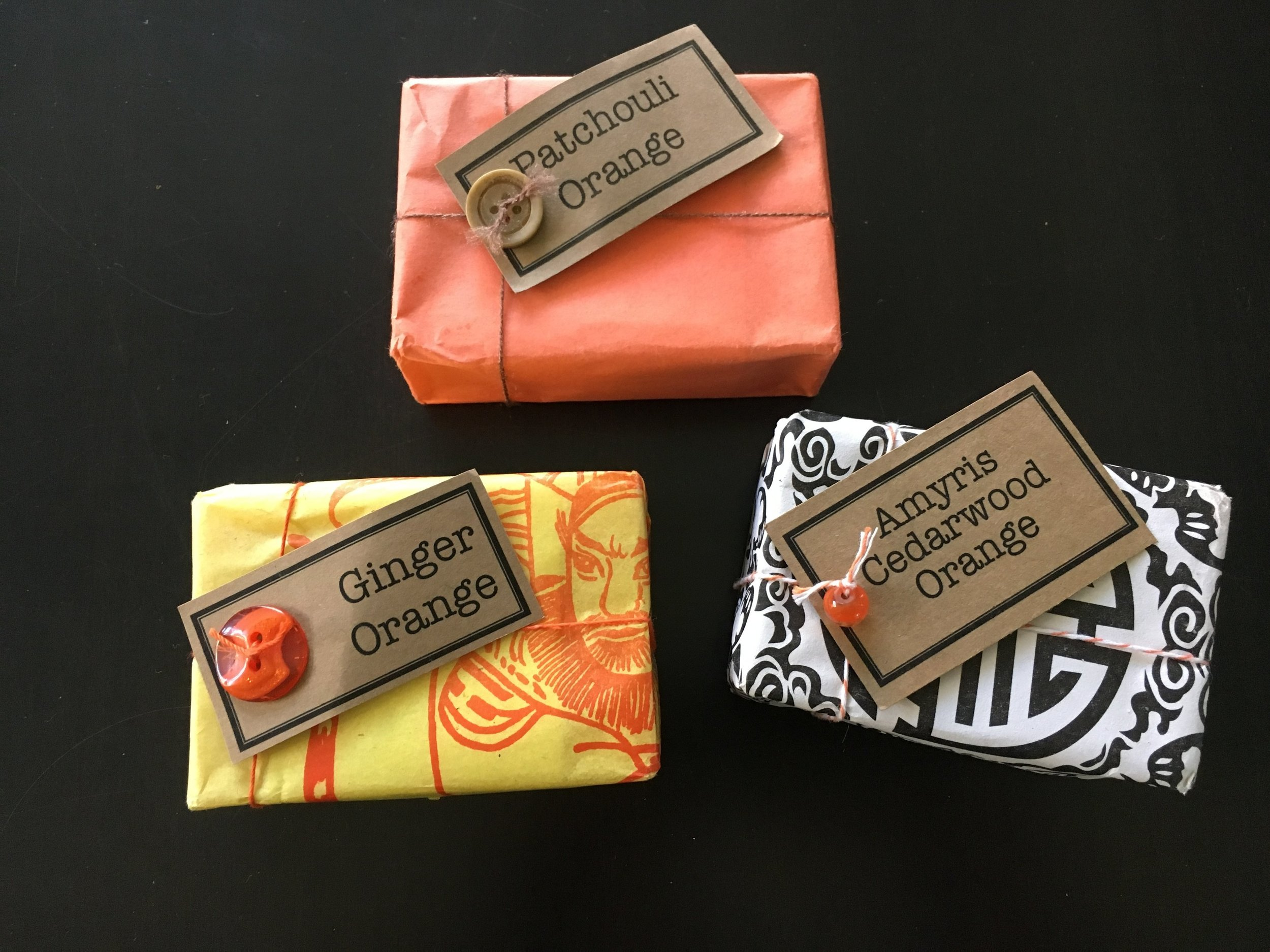 I bought these locally made soaps at a local store called Hunt & Gather. At first I was attracted to the colors of the packaging but when I read the ingredients and learned about the scents, I was hooked. These bars of soaps make a nice, kinda pricey (but we're supporting a local business), non-food  thoughtful pinch  for my wonderful neighbors.   So even if their feet were smelly, they won't be for long!