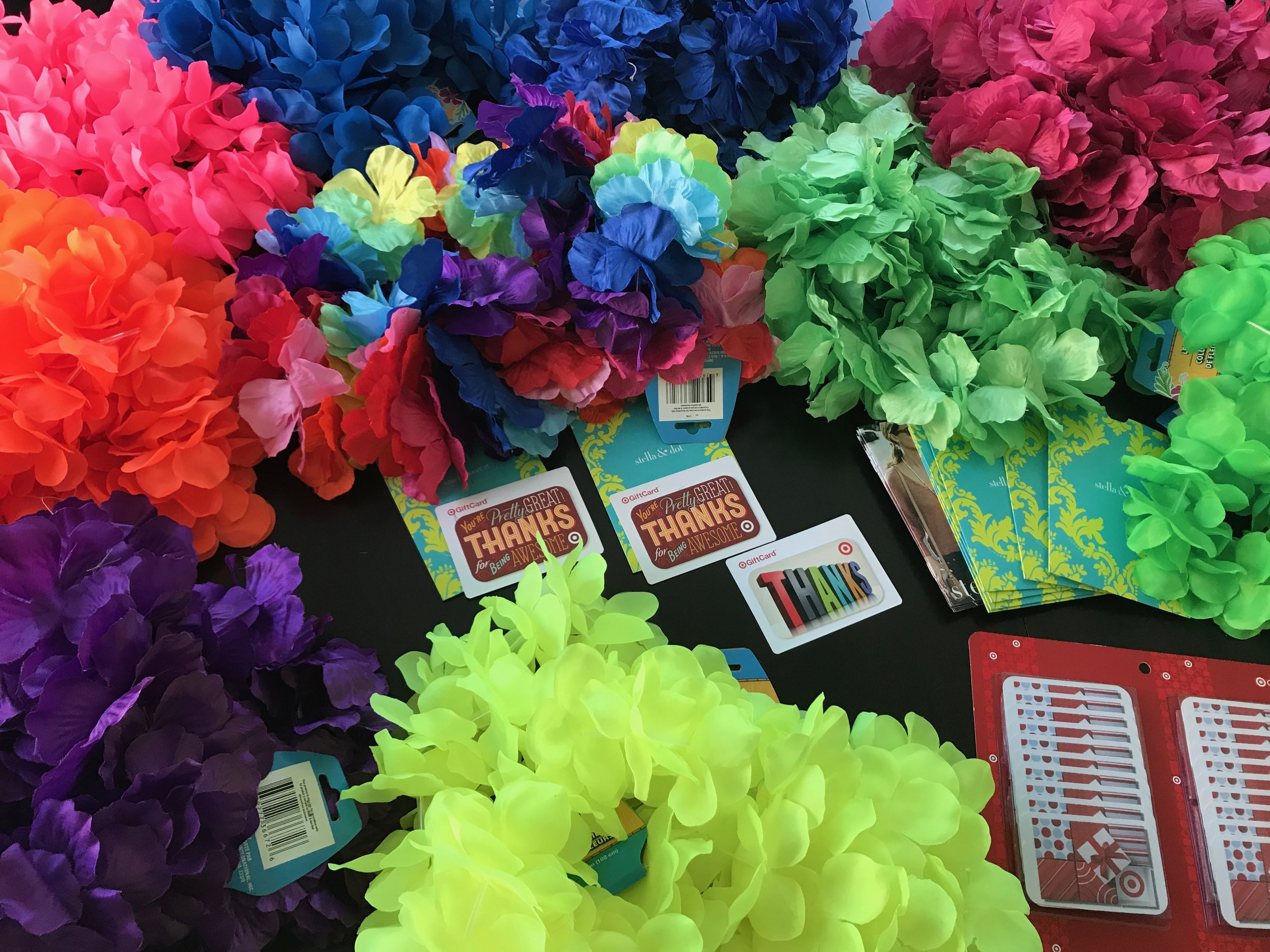 Went to Dollar Tree and bought 24 leis. Already have the Stella & Dot , Amazon and Target gift cards. Just need Barnes & Noble and Starbucks gift cards. The main teachers get the rainbow leis.