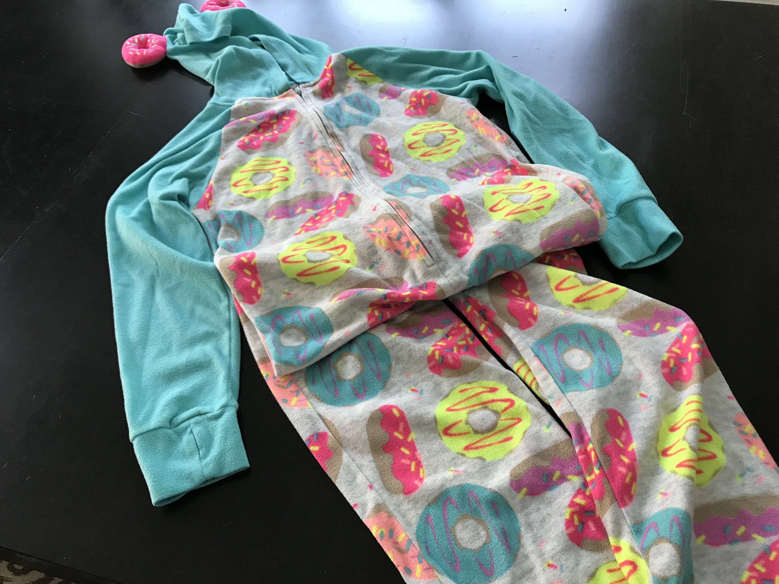 My daughter went to her first sleepover and the party favors included a personalized toiletry bag AND these awesome pajamas! It was as if each guest came home with birthday presents for themselves! Those are donuts, that look like ears, sewn onto the hood. Adorable!
