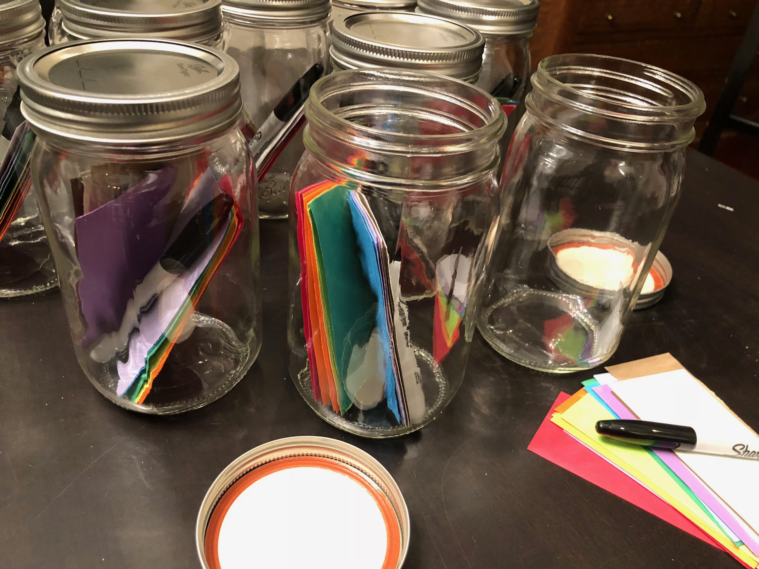 Each Gratitude Jar contains pieces of paper and a Sharpie.