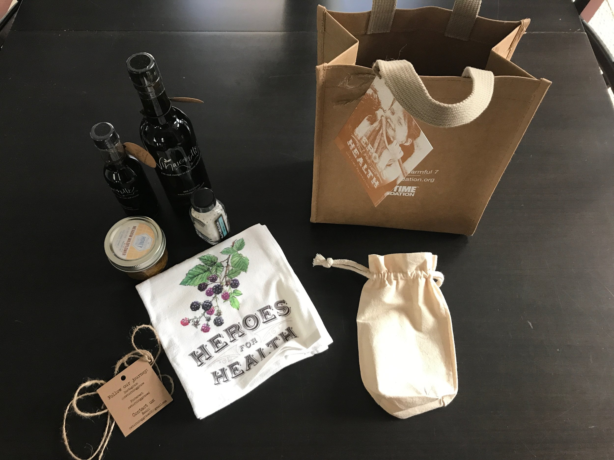 One of the best swag bags I ever received! The bag contained: local honey from my favorite honey company, Italian olive oil, blueberry vinegar, a tea towel and black truffle sea salt. YUM!