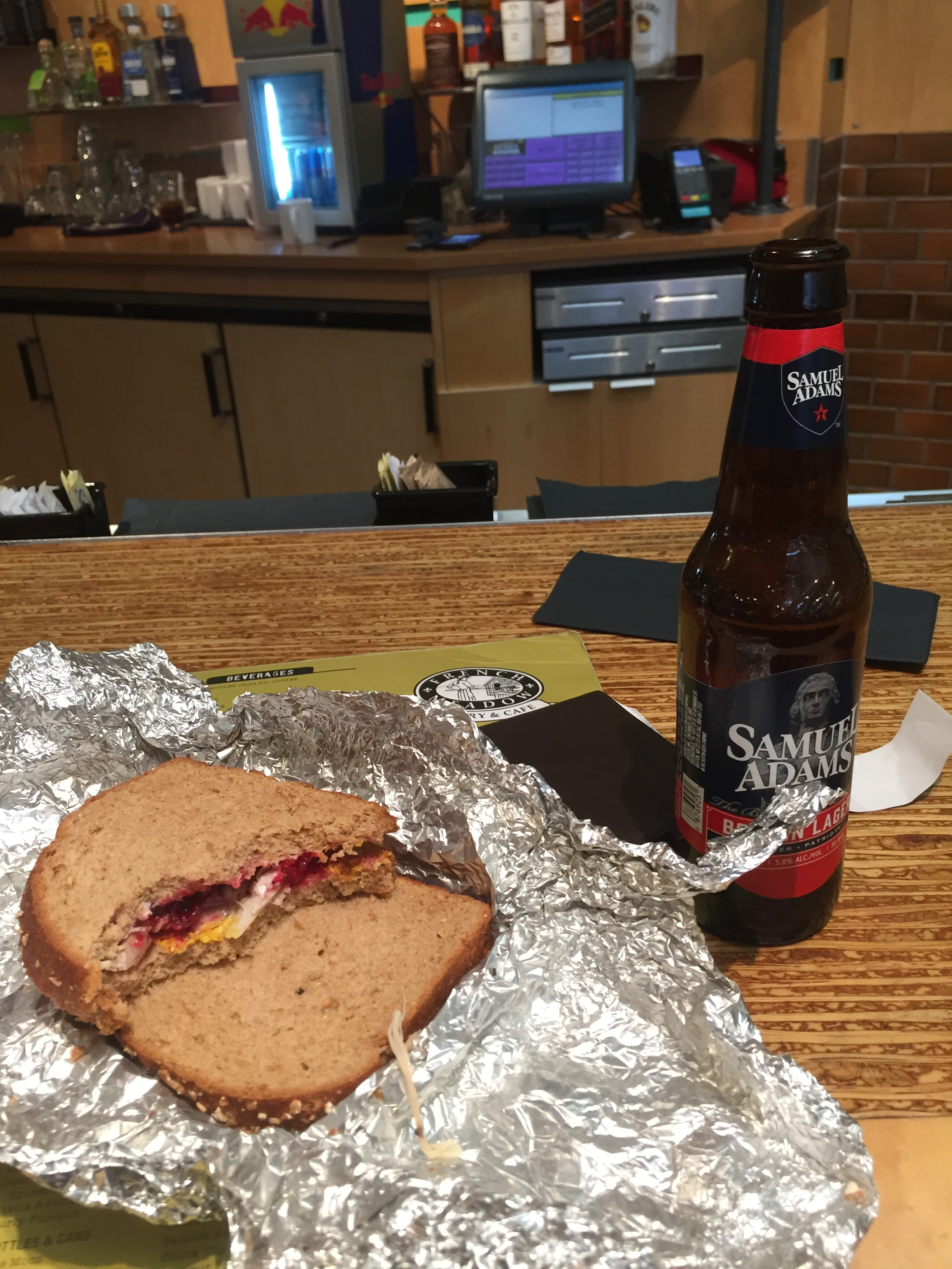 Text picture from John, my brother-in-law, who was visiting from Miami Beach. Turkey sammy with cranberry sauce and a beer at the airport.  Then another text the following day telling me he had his second sandwich and he loves leftovers! Yay!