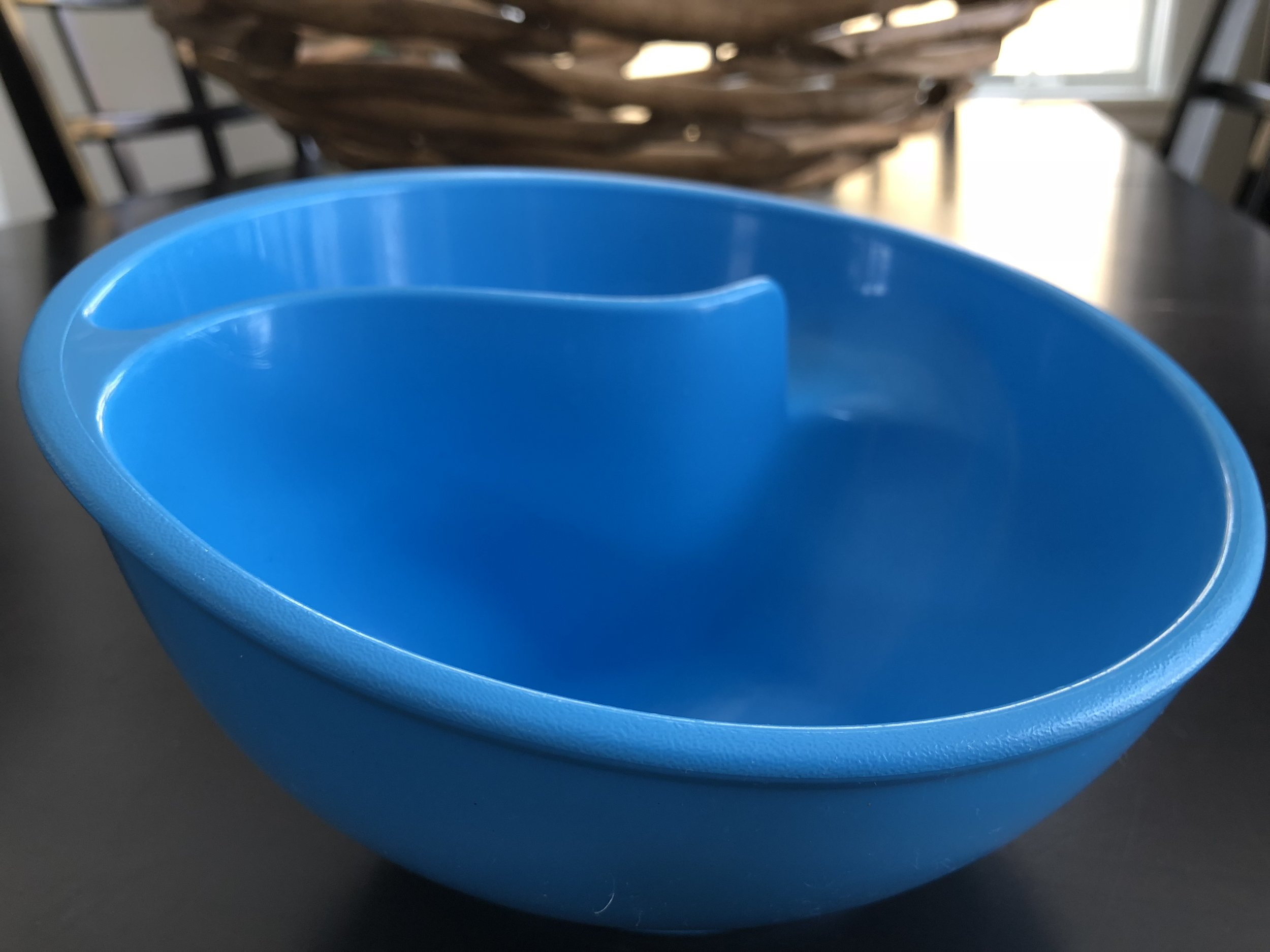 Here's a glimpse of my son's food pickiness or control issues. My son's cereal bowl keeps the cereal dry and not mushy because he controls when the cereal goes into the milk. I bought it years ago at Brookstone's - I think.