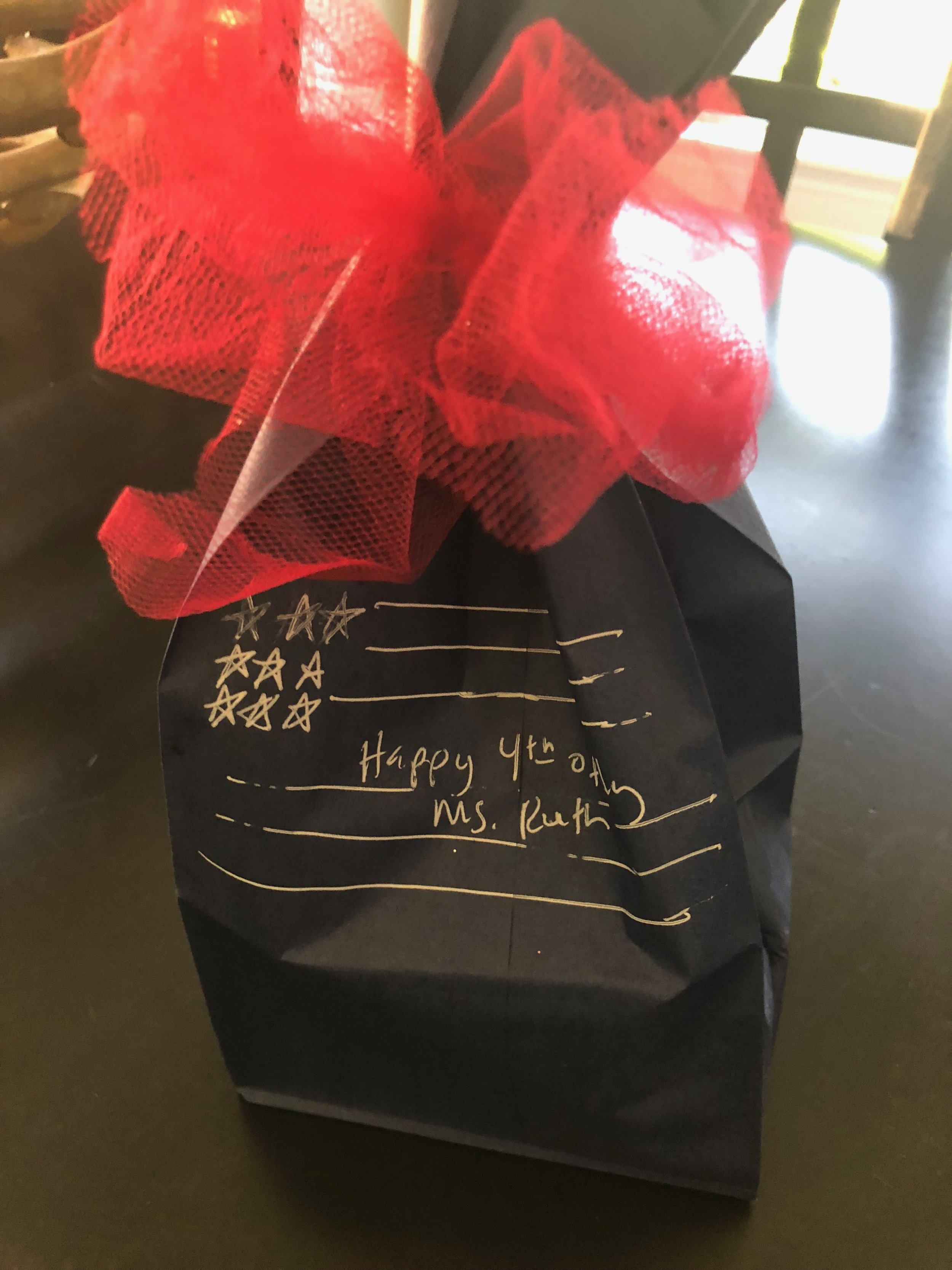 To give the crystal to our piano teacher, I wrapped it in white tissue, used a blue paper lunch bag and wrote a note with a white pen. I tied the bag with a strip of red tulle.