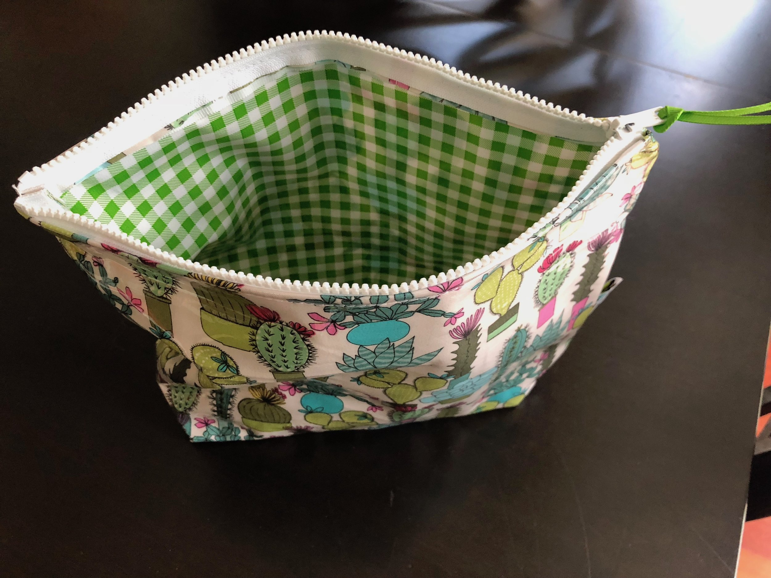 KT Design  makes easy to wipe off pouches so if there are spills, the oil cloth is up for the challenge.