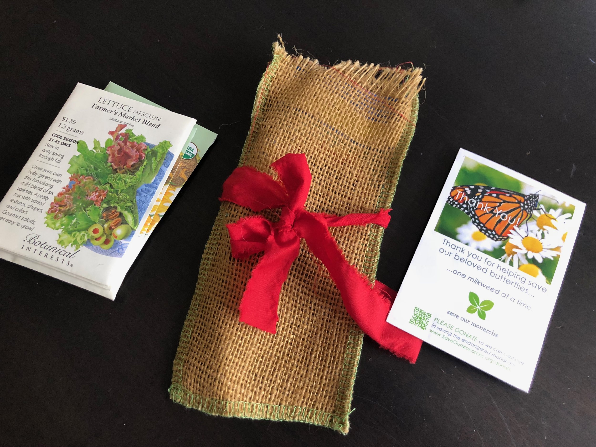 The most famous Blake Lower School parent Mary Guider, whipped these burlap gift bags together for the annual Appreciation Luncheon this Spring. Each bag included a packet of seeds which were sitting at our place settings for us to take home. She sprinkled more packets all around the food tables for decor but also for us to take home. I loved this  thoughtful pinch !