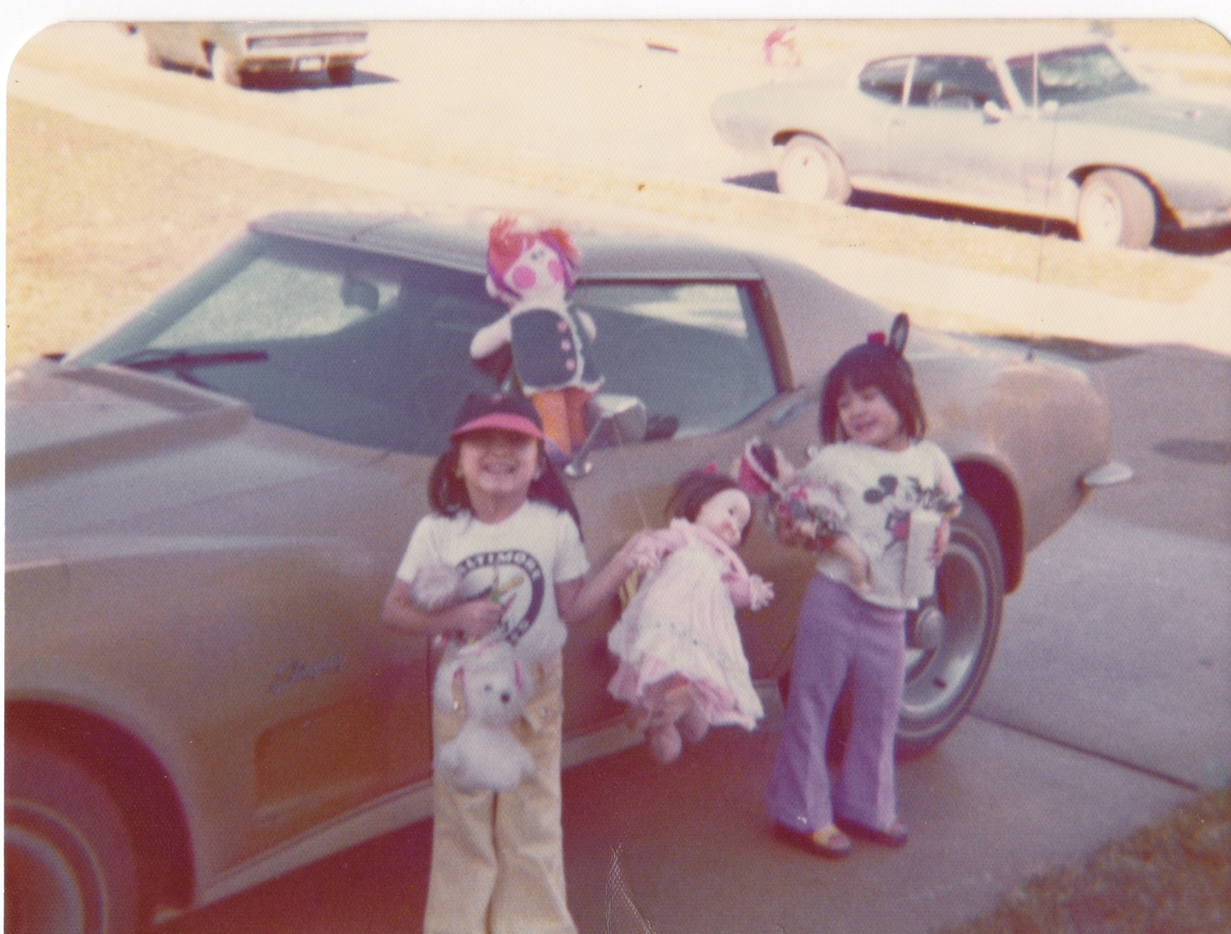 Here we are about 44 years ago. Jay-Jay is in the baseball cap and I've got my Disney ears on.
