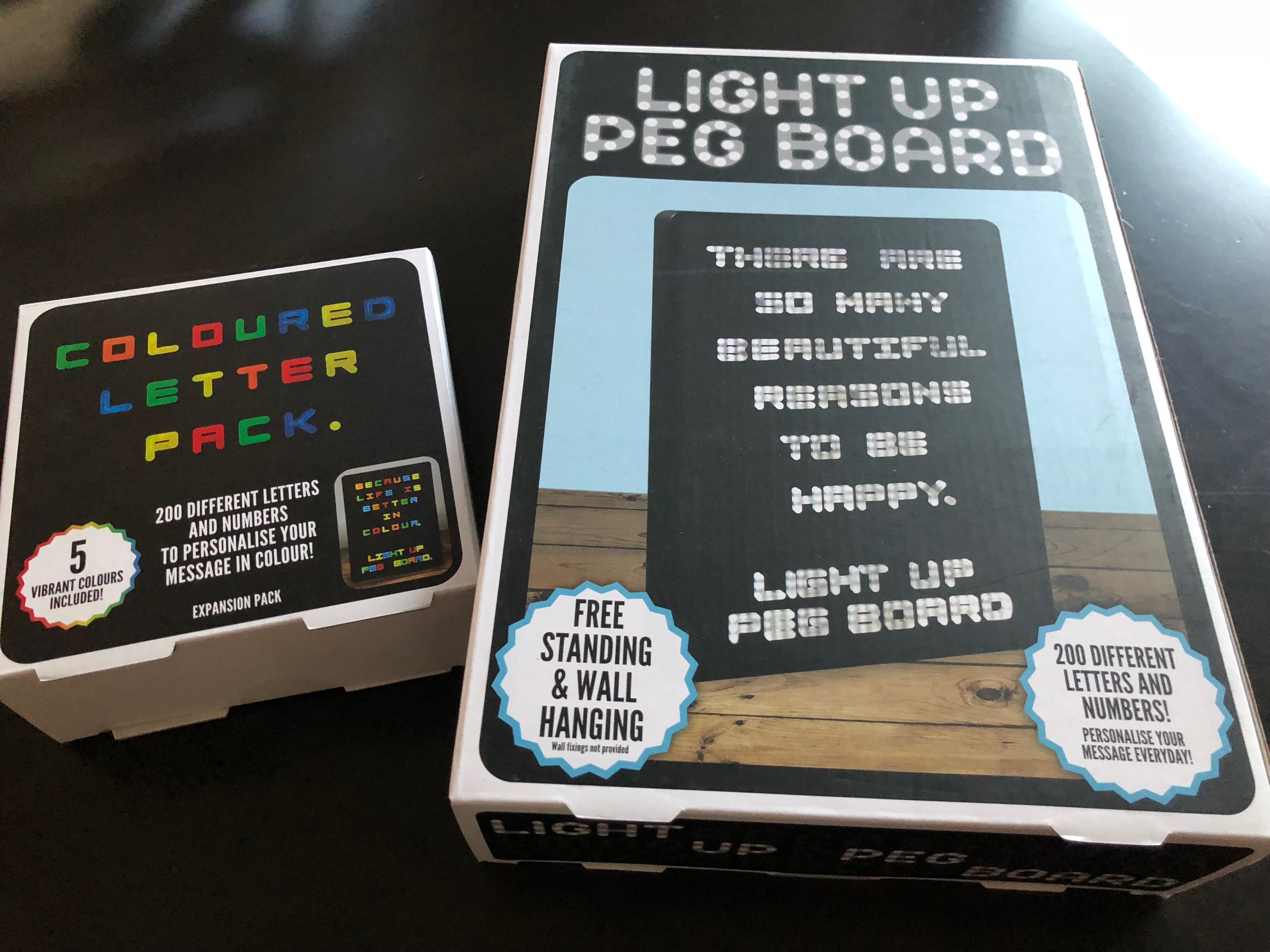 It's a modern day Lite Brite! Instead of having to plug it in, it's battery operated and can be hung on the wall. Classy!