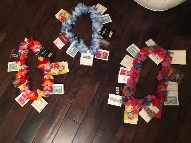 """Families picked up gift cards in all sorts of denominations to give to the hockey coaches and I attached them to the leis. The coaches got to go on a shopping """"vacay""""."""