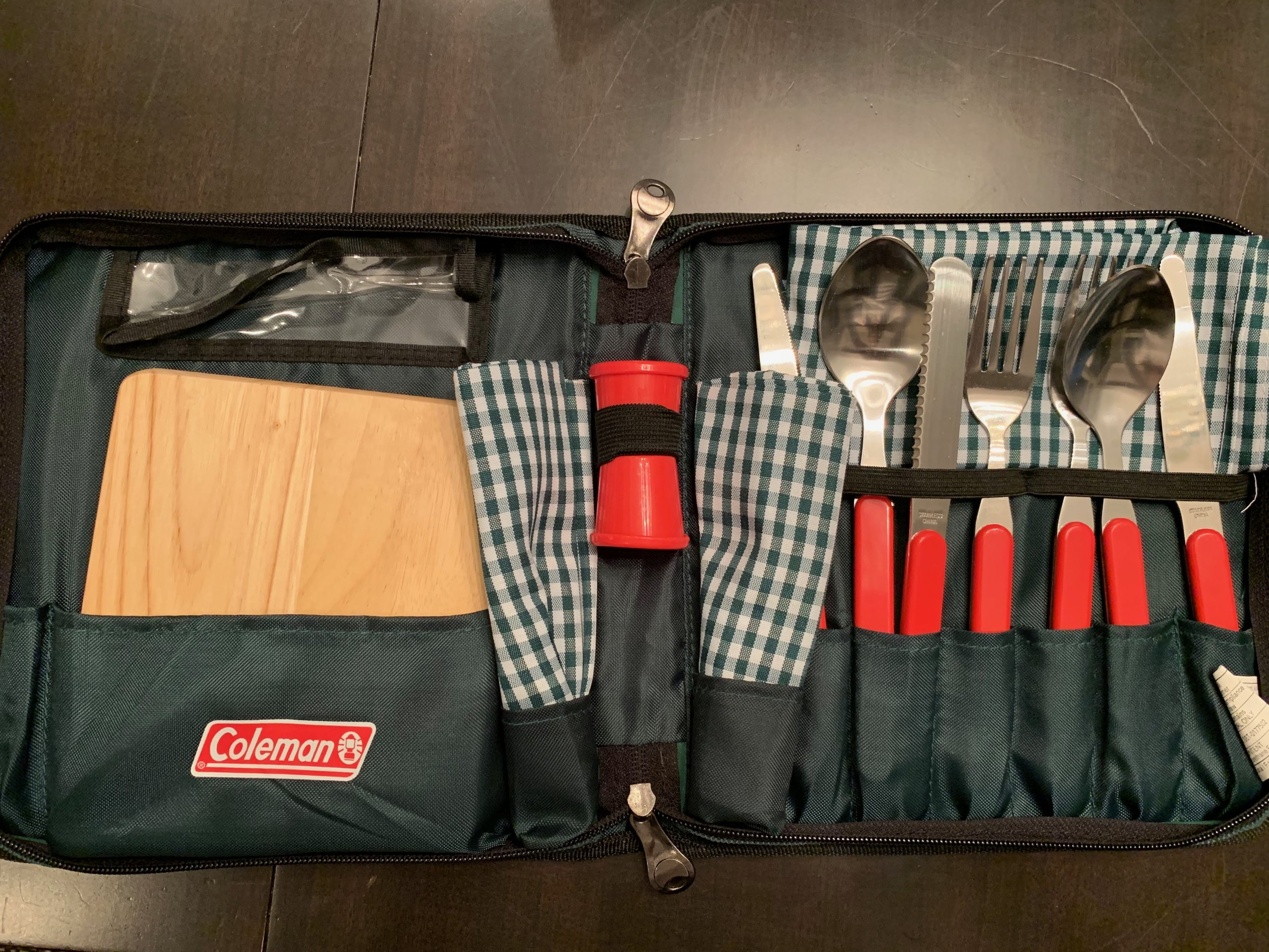 This kit has all we really need to cover the most basic tasks. Chopping board, two napkins, salt/pepper containers, two sets of flatware and serrated knife. This was an anniversary present from a lovely couple; both have since passed away. I think of them often when we use it.