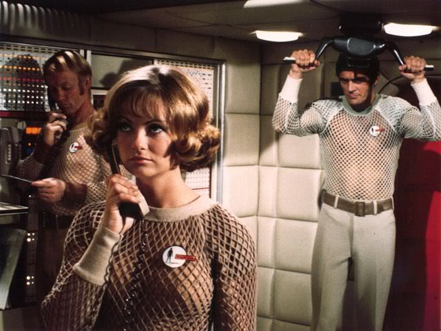 "Standard submarine-wear of the 1980s, as envisioned in 1969 on Gerry Anderson's first live-action series, ""UFO."""