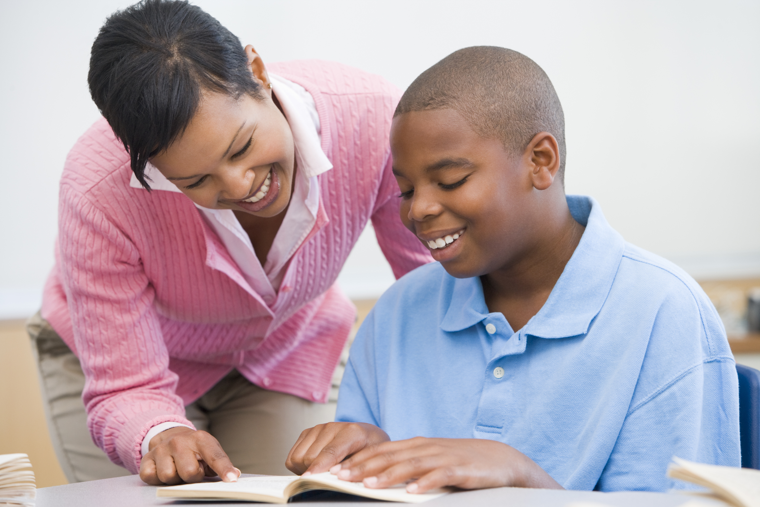 bigstock-Student-In-Class-Reading-With--3917310.jpg