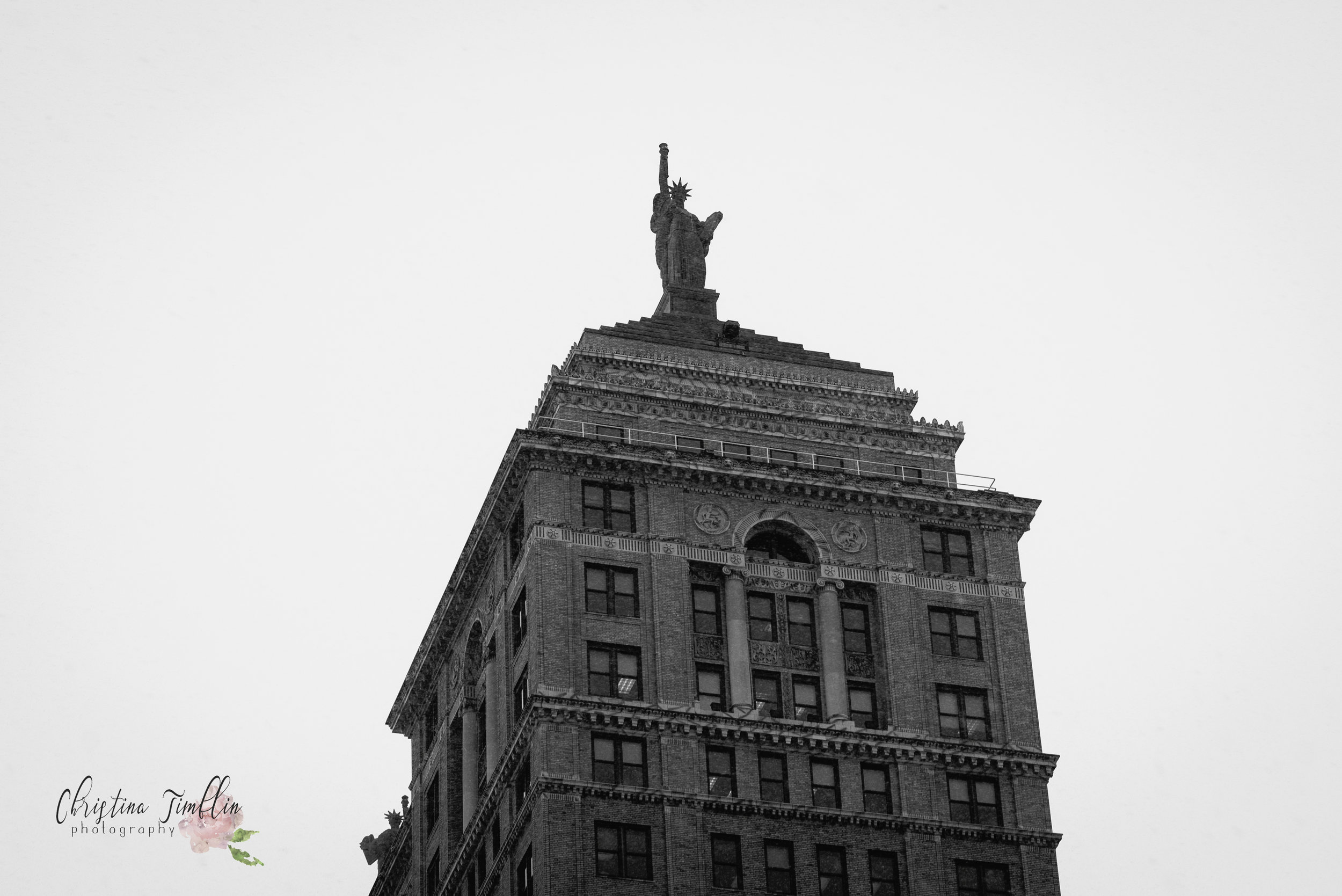 Today's photo is of the beautiful Liberty Building. It was built in 1925, and at that time, was the largest office building downtown. The building originally had 3 Statue of Liberty replicas standing 36' tall. Just the two facing east and west on the roof remain. The Liberty building is currently the 5th tallest building in Buffalo.