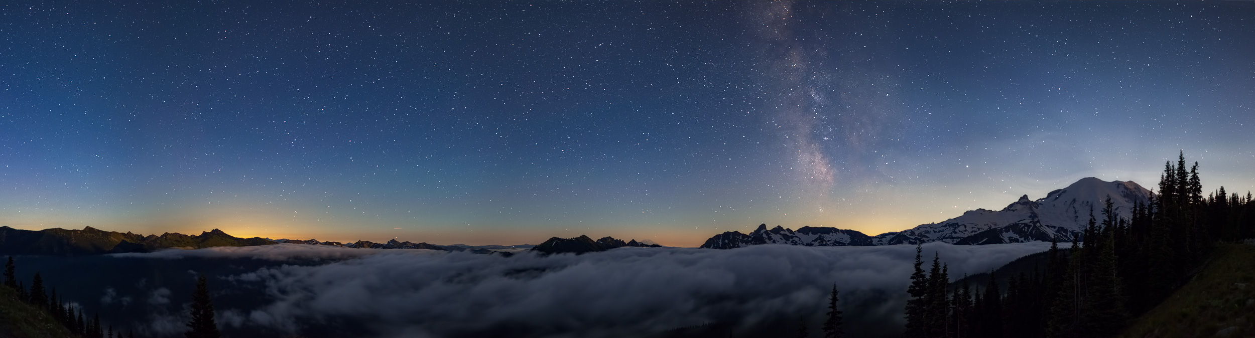The Milky Way at Mount Rainier National Park. Took this just after the moon went behind Rainier, with most of the cloud bank still intact.