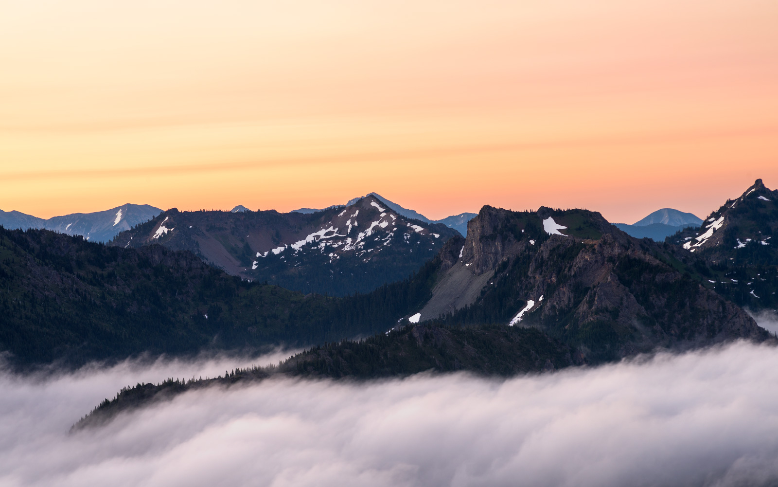 Sunrise at Mount Rainier, looking south-east. Got what was left of the cloud bank during the night, in the frame.
