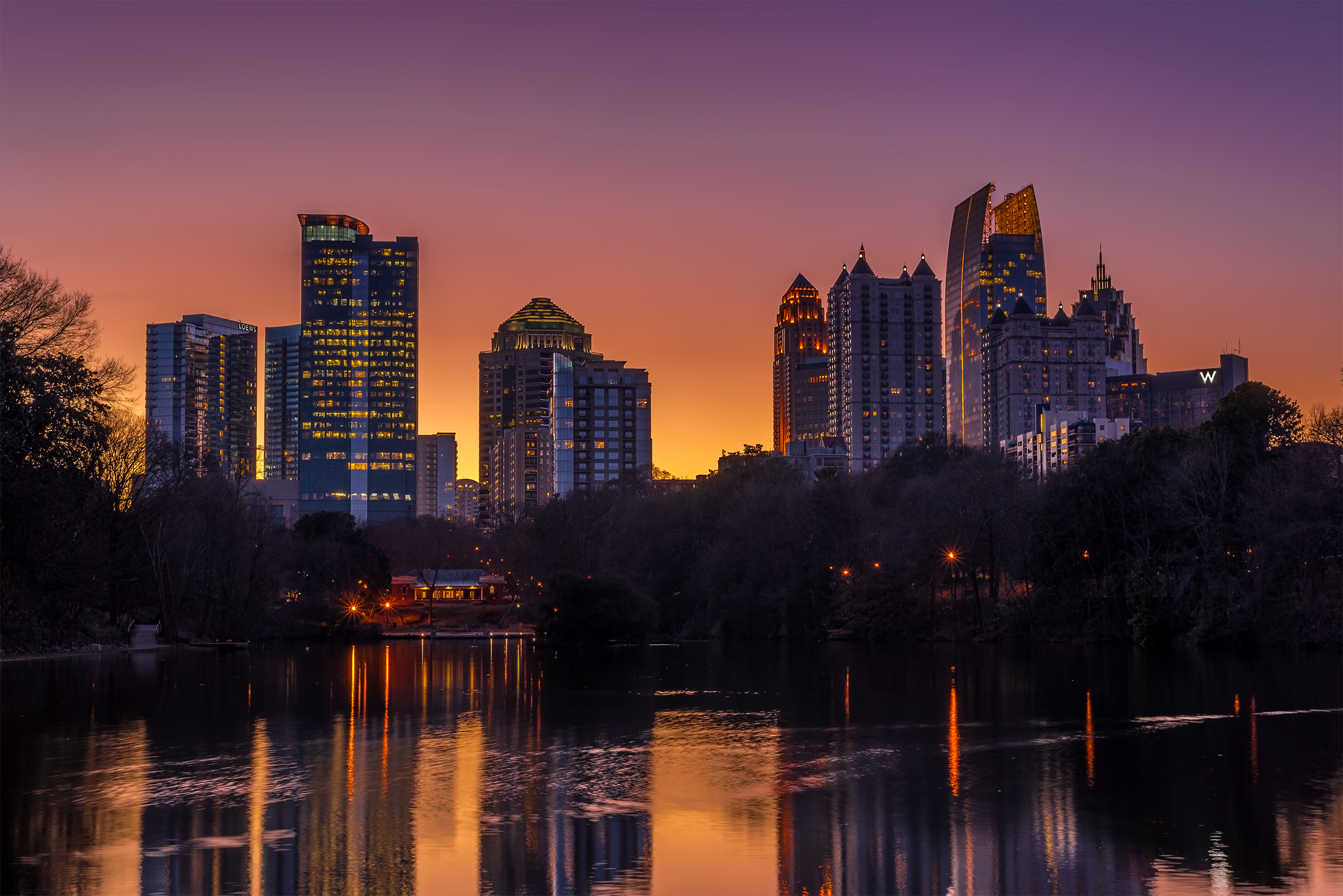 Piedmont Park, overlooking Lake Clara Meer and the Atlanta Midtown skyline at sunset.