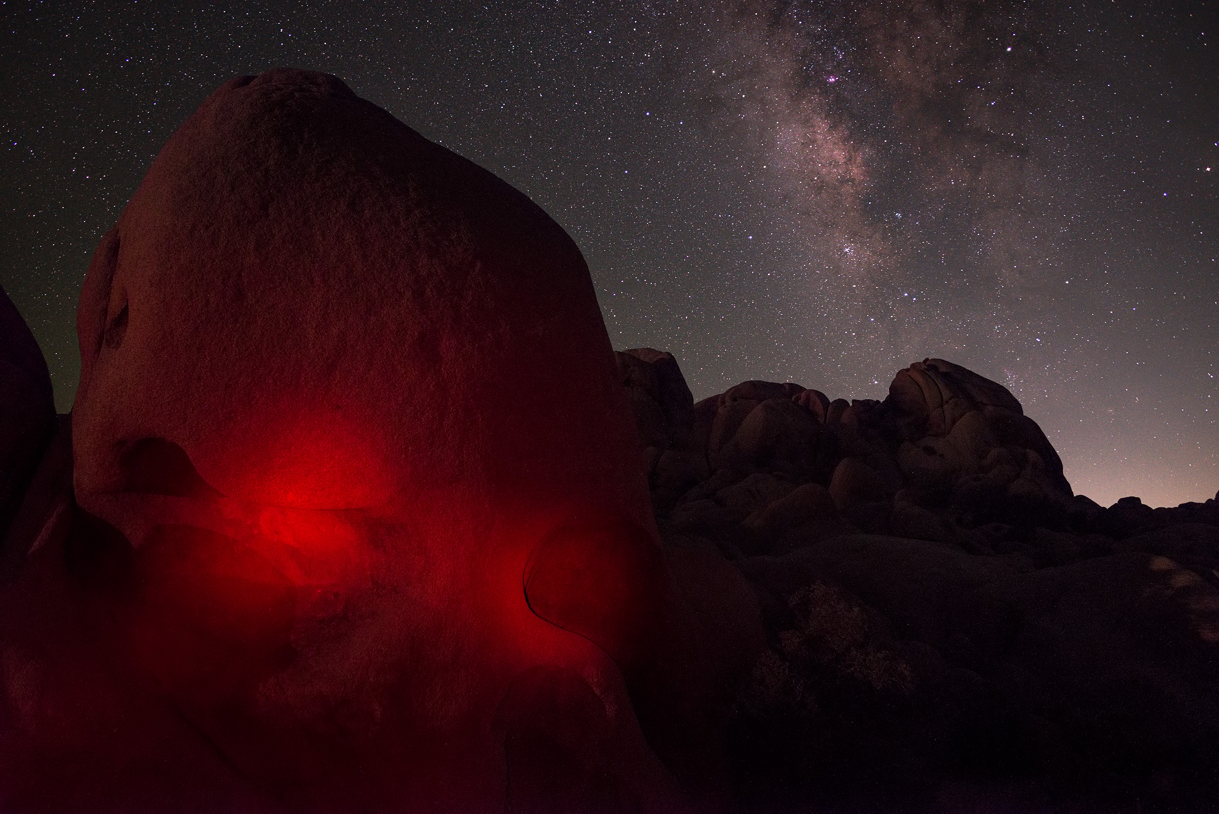 Skull Rock with light-painted eyes and the Milky Way.