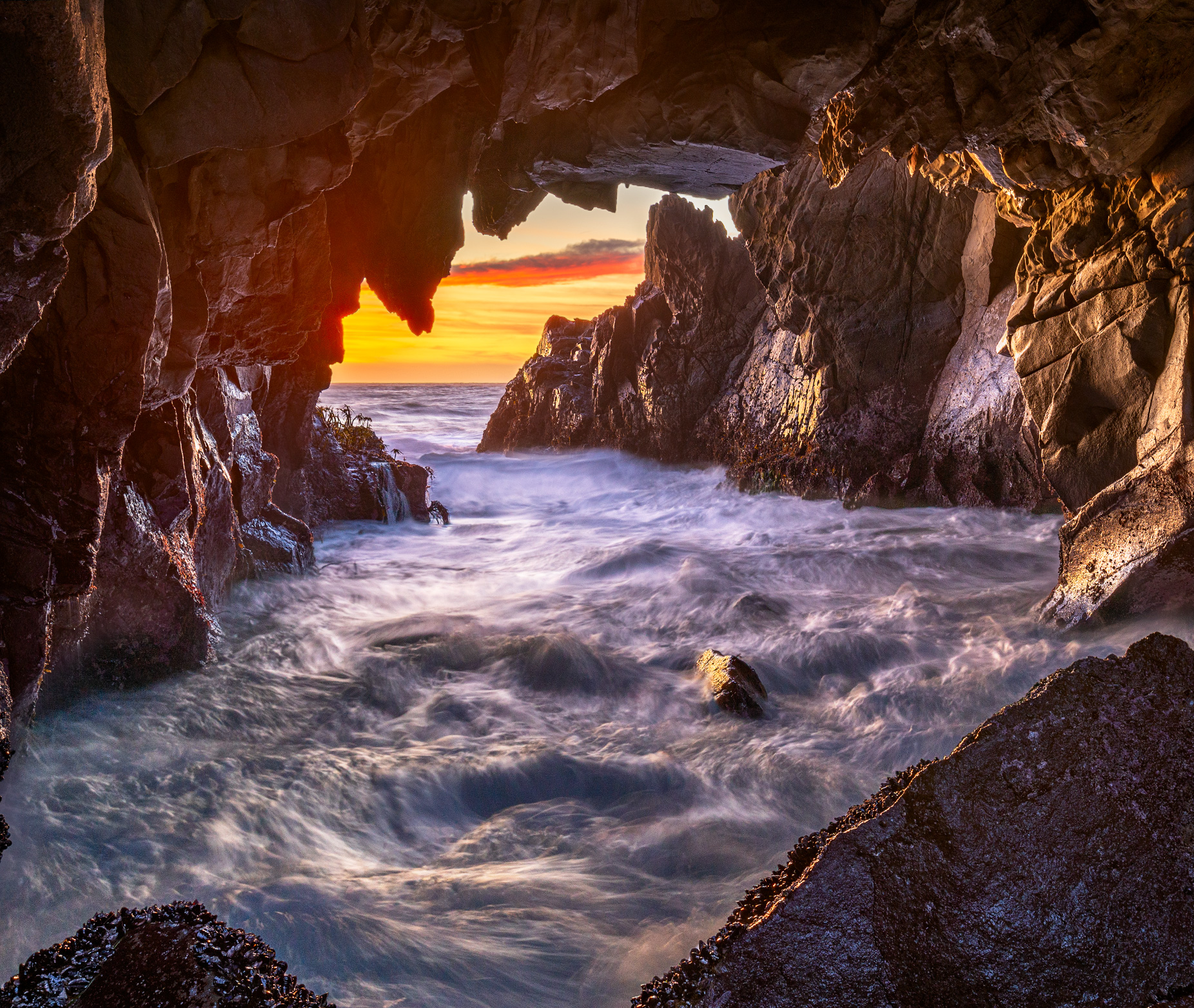 Sunset in one of the sea caves at Pfeiffer Beach, Big Sur.