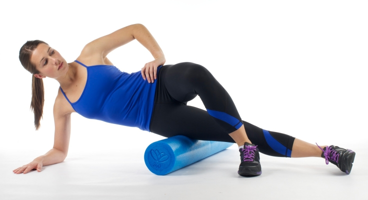 This pictures is demonstrating how foam roll your IT band.
