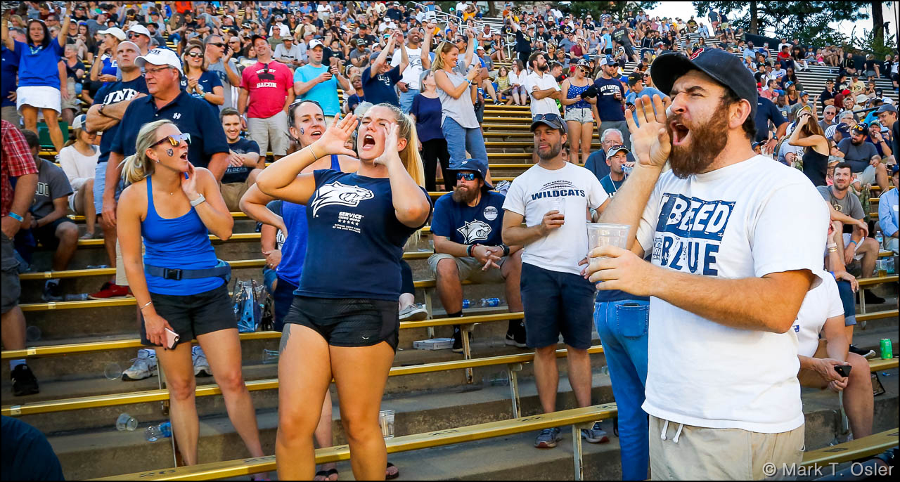 UNH fans holler in support of their trailing Wildcats late in the third quarter. UNH had just narrowed the score to 38-14.