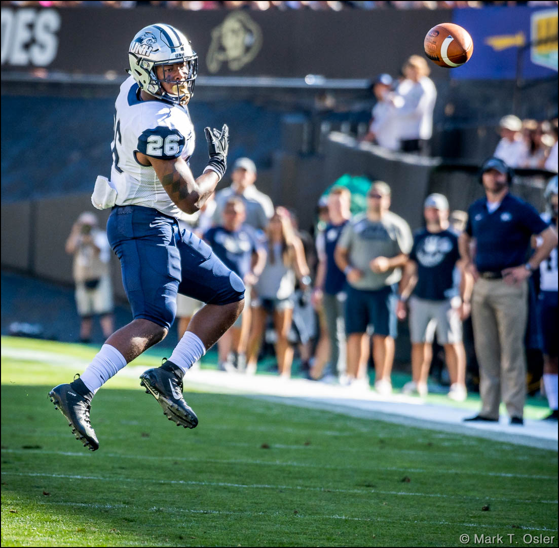 UNH running back Carlos Washington, JR. (#26) watches a pass from quarterback Christian Lupoli (not shown) sail over his head for an incompletion in the second quarter.