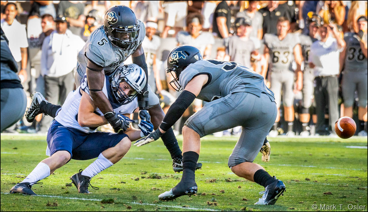 UNH wide receiver Neil O'Connor (#82) is unable to pull in a pass under pressure from CU linebackers Davion Taylor (#5) and Nate Landman (#53) early in the third quarter.