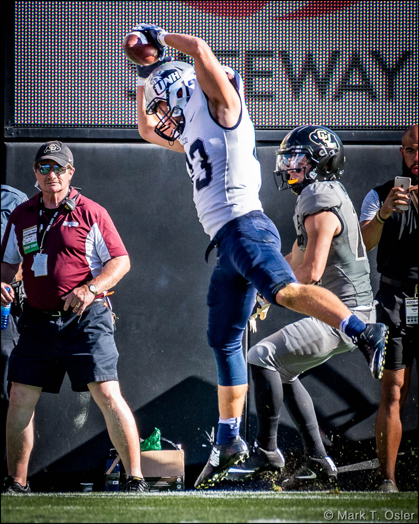 UNH safety Evan Horn (#33) makes sure to get a foot in bounds after intercepting a pass from CU quarterback Steven Montez (not shown) intended for CU wide receiver Jay MacIntyre (#14) in the second quarter.