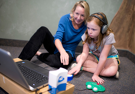 Interactive-Metronome-child-and-therapist.jpg