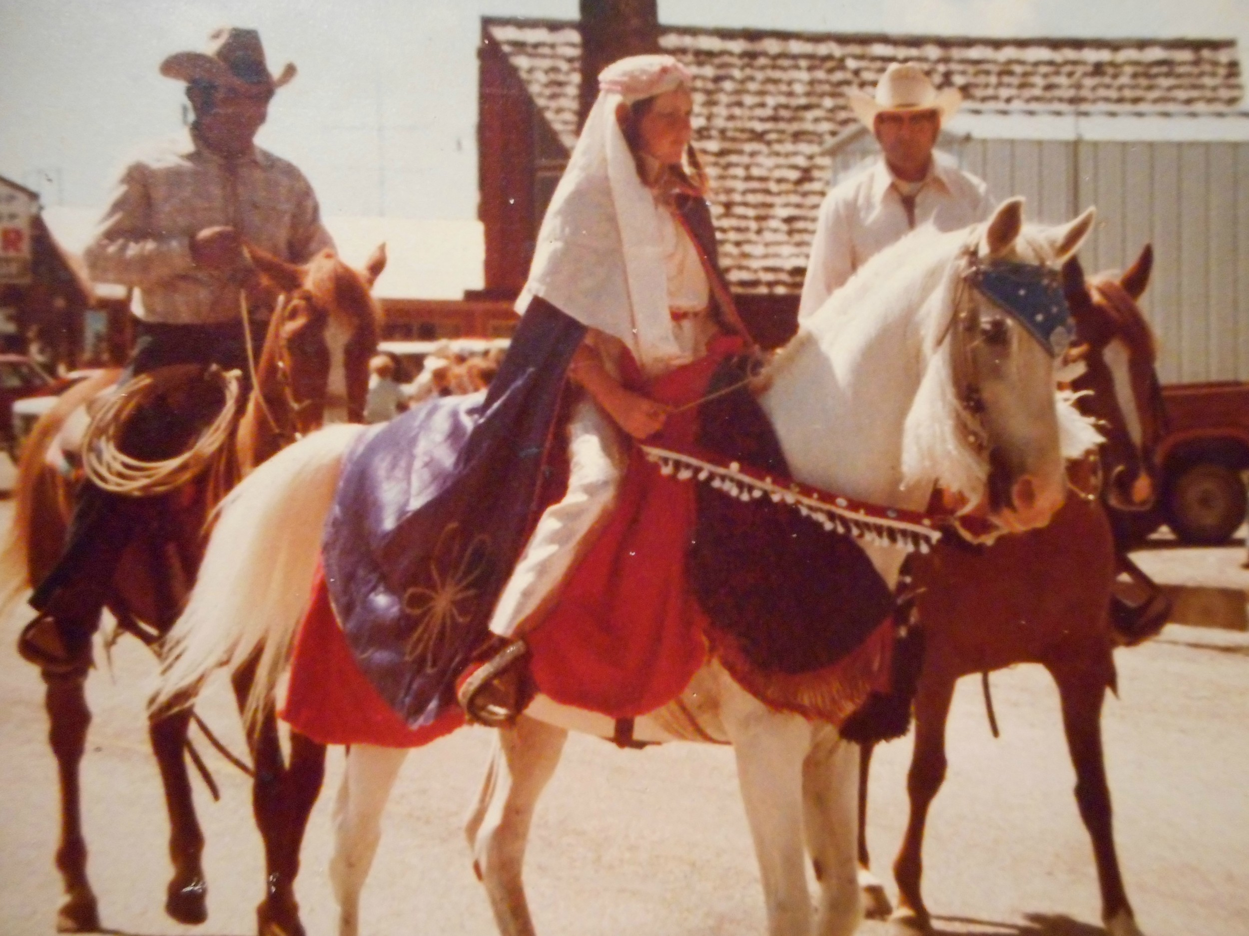 Anne, 11 years old, on Lipizzaner, Nibber, in 4th of July parade